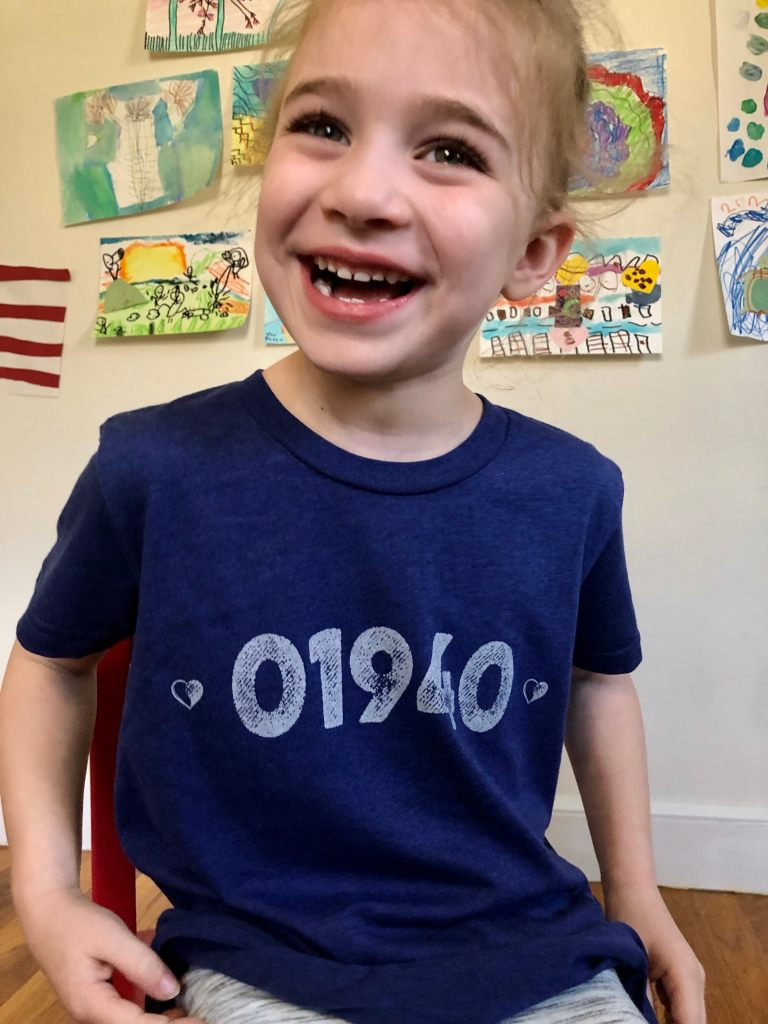 Smiling girl in 01940 tshirt